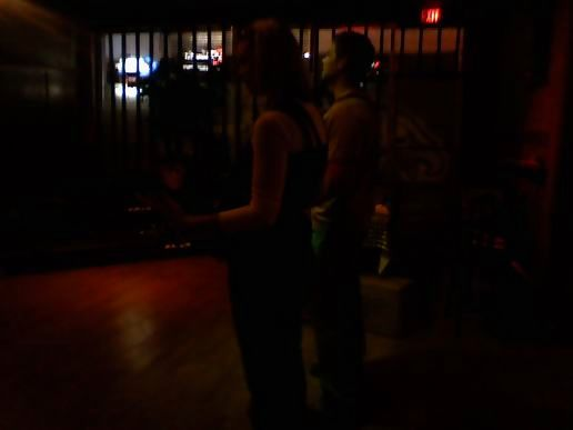 2 playing Guitar Hero at the bar