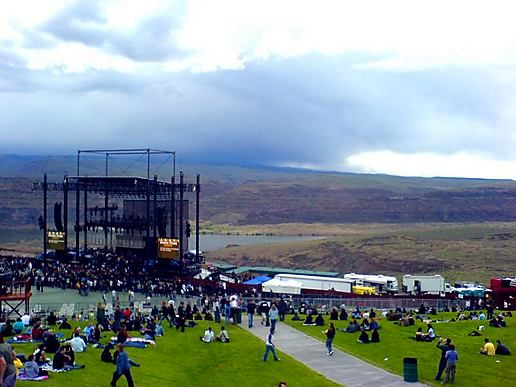 the sun lowers behind the main stage