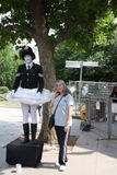 TOURIST POSING NEXT TO WEIRD POLICEMAN