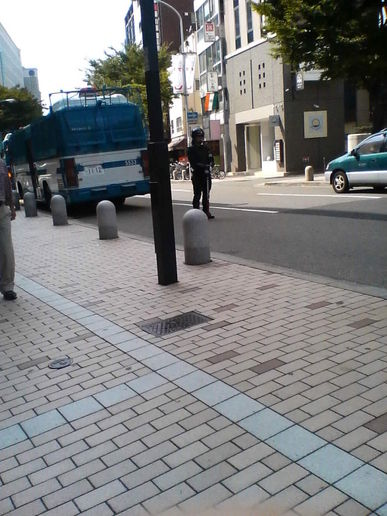Japanese policeman guarding at Japanese Communist Party Street Speech